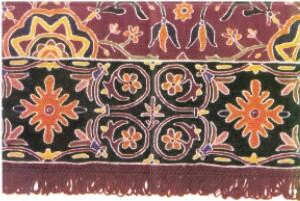 Tapete com contornos bordados a ponto de flor