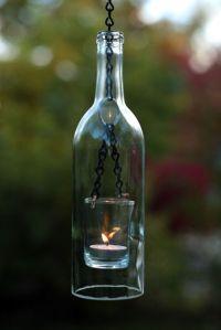 Suporte para velas com garrafas de vidro